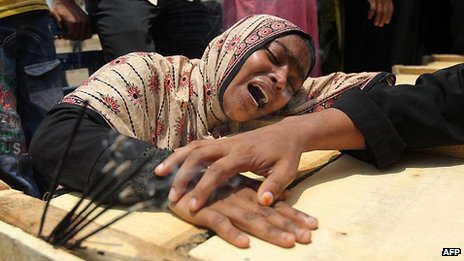 Woman grieves over relative lost in Dhaka building collapse. 9 May 2013
