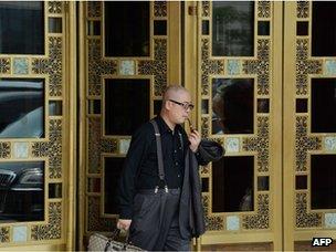 Man leaving upmarket restaurant in Beijing