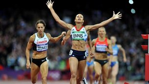 "Jessica Ennis celebrates winning gold in the Women""s Heptathlon after finishing the 800m at the Olympic Stadium, London"