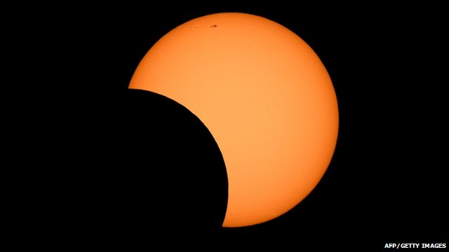The moon crosses in front of the sun as seen from the Sydney Observatory during an annular eclipse on May 10, 2013