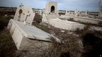 Tombs photographed in Epecuen, Argentina, on 7 May 2013