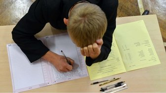 Boy doing an exam.
