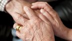 Carer holding elderly person&#039;s hand