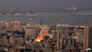 Flames are seen as a shell, one of several, slams into the city and surrounding ocean of the northern Israeli city of Haifa, 6 August 2006.