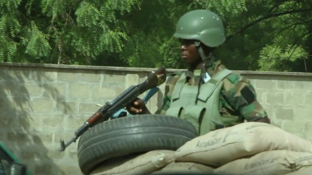 Soldier at checkpoint