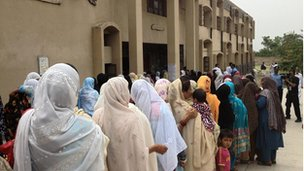 Women wait in line to vote