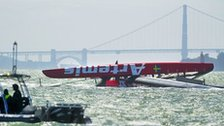 The capsized Artemis catamaran