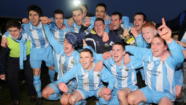 Warrenpoint Town players celebrate promotion to the Irish Premiership