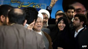 Mr Rafsanjani (C) arrives to register candidacy - 11 May