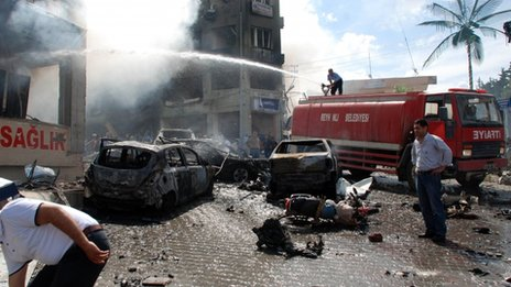 Firefighters douse smoking rubble after the blasts in Reyhanli, Turkey, 11 May
