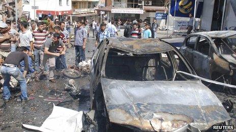 Mangled cars at a bomb scene in Reyhanli, Turkey, 11 May