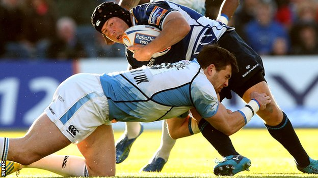 Sean Lamont tackles Richardt Strauss at the RDS