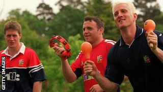 (From left) Ronan O'Gara, Rob Henderson and Will Greenwood play musical instruments before the 2001 Lions tour