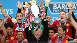 Man Utd celebrate with the Premier League trophy