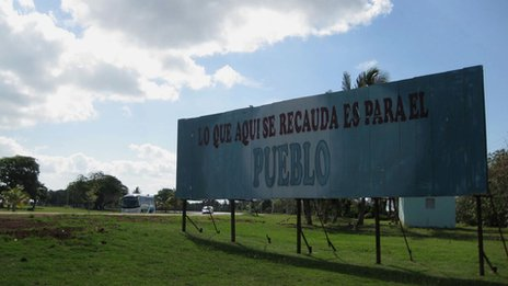 "A sign at the Varadero golf club reads ""The proceeds made here go to the people"""