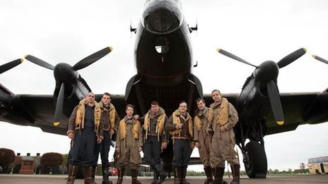 The actors line up before a Lancaster Bomber