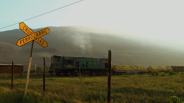 A freight train at a railway crossing on the Arica-La Paz railway (file photo)