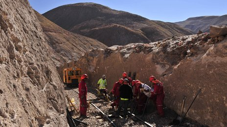 Workers carry out maintenance on the Arica-La Paz railway