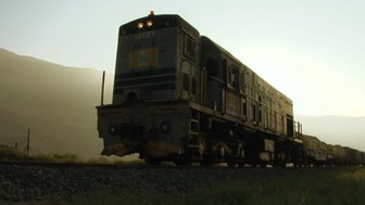 A train carries freight on the Arica-La Paz railway (file photo)
