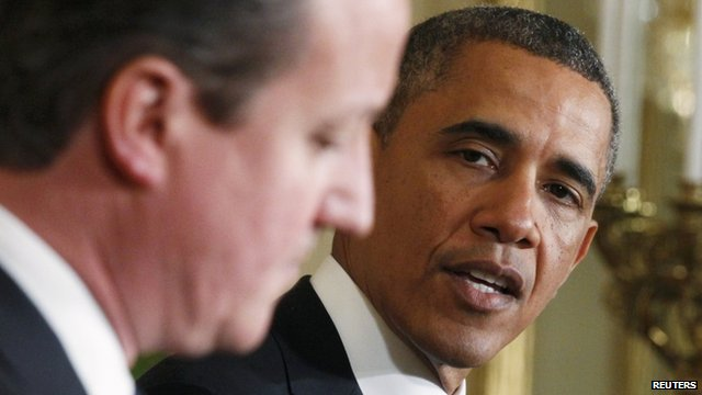 "U.S. President Barack Obama (R) looks toward Britain""s Prime Minister David Cameron (L) during a joint news conference in the East Room of the White House in Washington"
