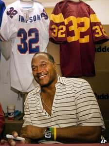 OJ Simpson signs autographs during an event hosted by the NecroComicon horror convention in Northridge, California