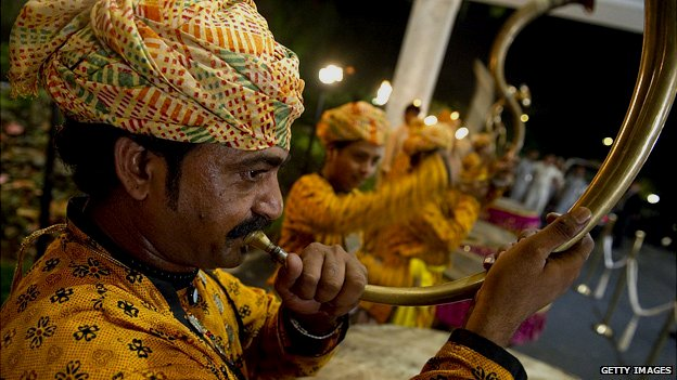 Man playing traditional Punjabi horn