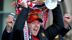 Paul Scholes celebrates with the Premier League trophy