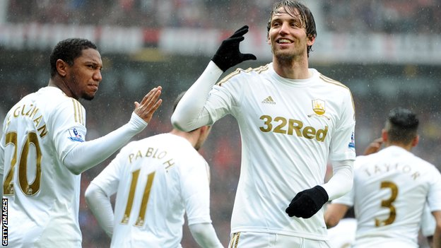 Michu celebrates scoring at Old Trafford