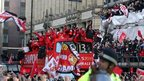 Bus carries Manchester United team through city's streets in victory parade