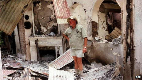 A famer in Headlands in Zimbabwe in 2002 standing amidst the ruins of his farmhouse burnt by suspected war veterans