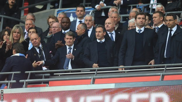 Man City manager Roberto Mancini (left) after shaking hands with the club's board after the FA Cup defeat by Wigan