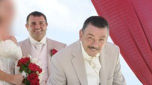 Christopher Welsh Sr (front) at the wedding of his son, Christopher Jr (back)