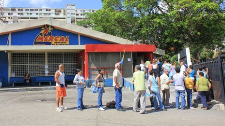 People queuing outside a Mercal supermarket