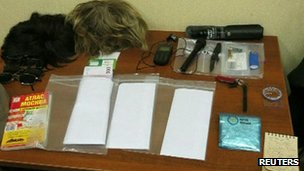 Still of the items said to have been in Mr Fogle's possession (14 May 2013)