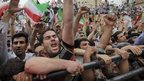 Supports of  Iranian President Mahmoud Ahmadinejad at a rally in Tehran 2009