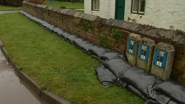 Sandbags around farmhouse