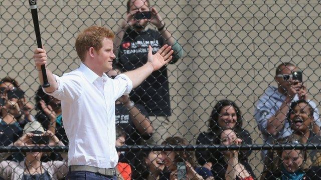 Prince Harry playing baseball