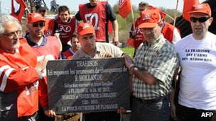 "Unionists and employees of steel giant ArcelorMittal's blast furnaces at Florange, eastern France, carry a mock tombstone bearing the legend: ""Betrayal - Here lie the broken promises of F Hollande"""