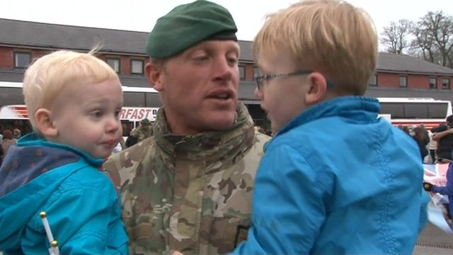 Colour Sgt Dominic Conway with his two sons