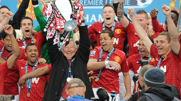 Manchester United manager Sir Alex Ferguson lifts the Premier League trophy