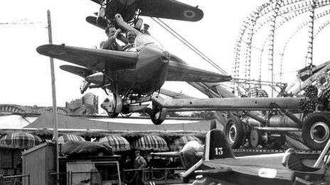 Visitors on a fairground ride