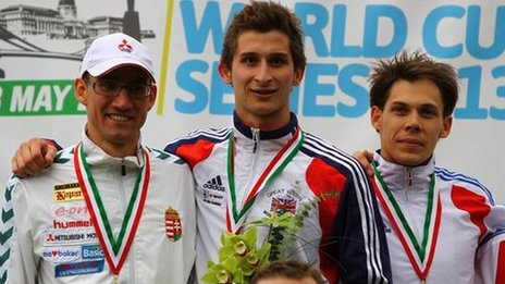 Jamie Cooke (centre) receives his World Cup gold medal