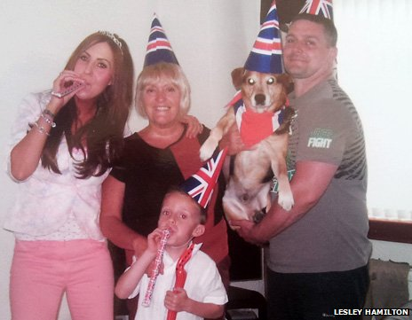 Axle and his family wearing Union Jack hats during Diamond Jubilee celebrations