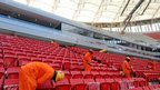 Workers place the seats in the National Stadium of Brasilia