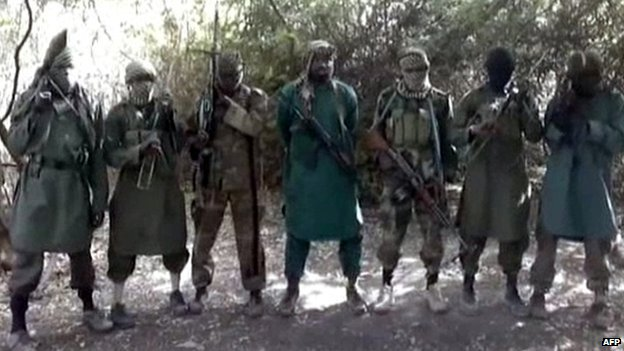 A picture taken from a video distributed to Nigerian journalists in the country&#39;s north and obtained by AFP on March 5, 2013 reportedly shows Abubakar Shekau (C), the suspected leader of Nigerian Islamist  group Boko Haram
