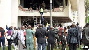 Rescue workers at UN building in Abuja, Nigeria - 26 August 2011
