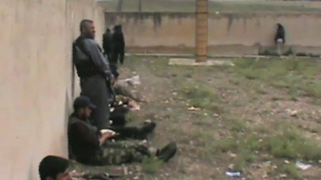 Online video footage claimed to show rebel fighters flanking the prison walls