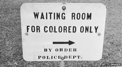 Sign reading 'waiting room for colored only'