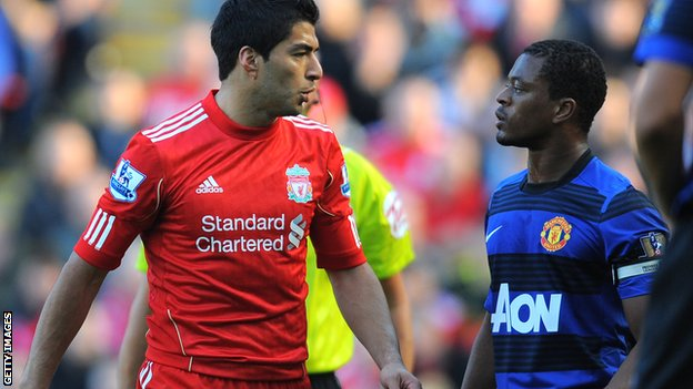 _67631017_suarez_evra_getty