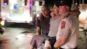 An injured man is carried to an ambulance in Granbury, Texas (15 May 2013)